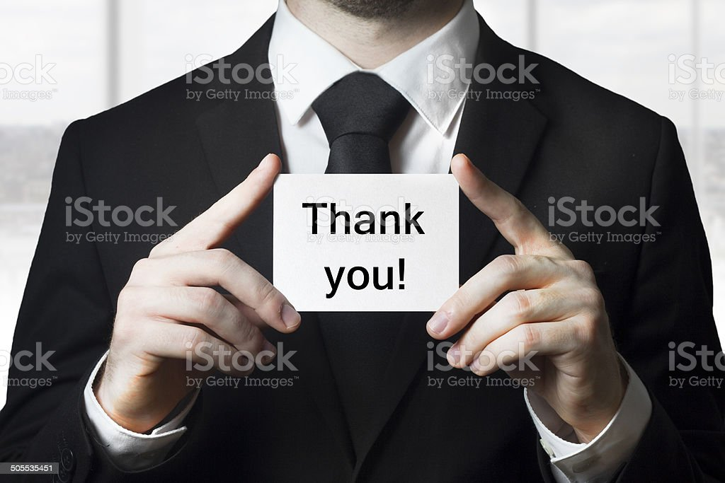 businessman holding card thank you stock photo