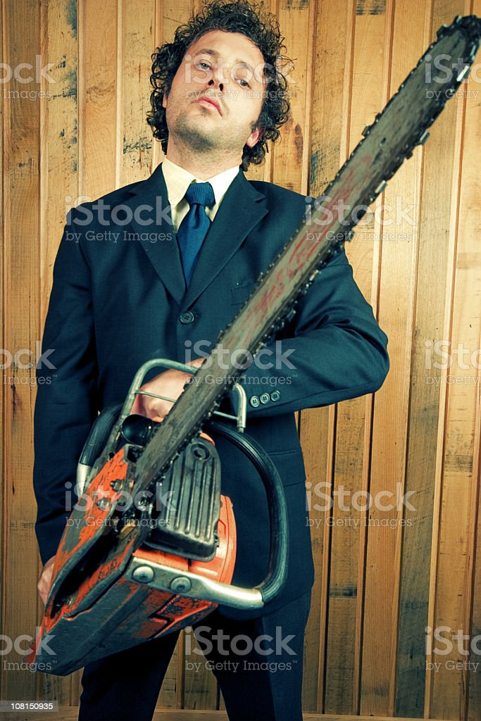 Businessman Holding Chainsaw royalty-free stock photo