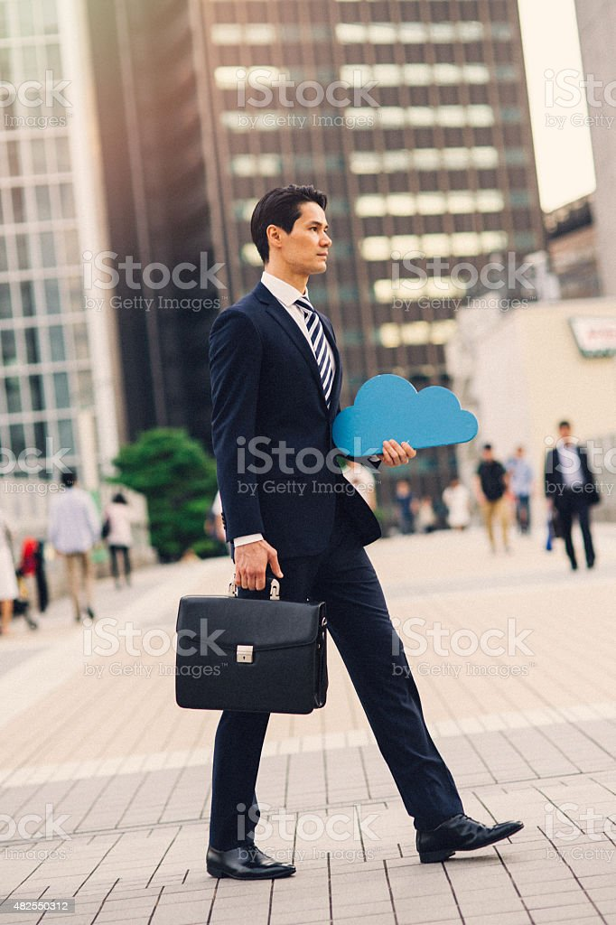 Businessman holding cloud computing icon outside stock photo