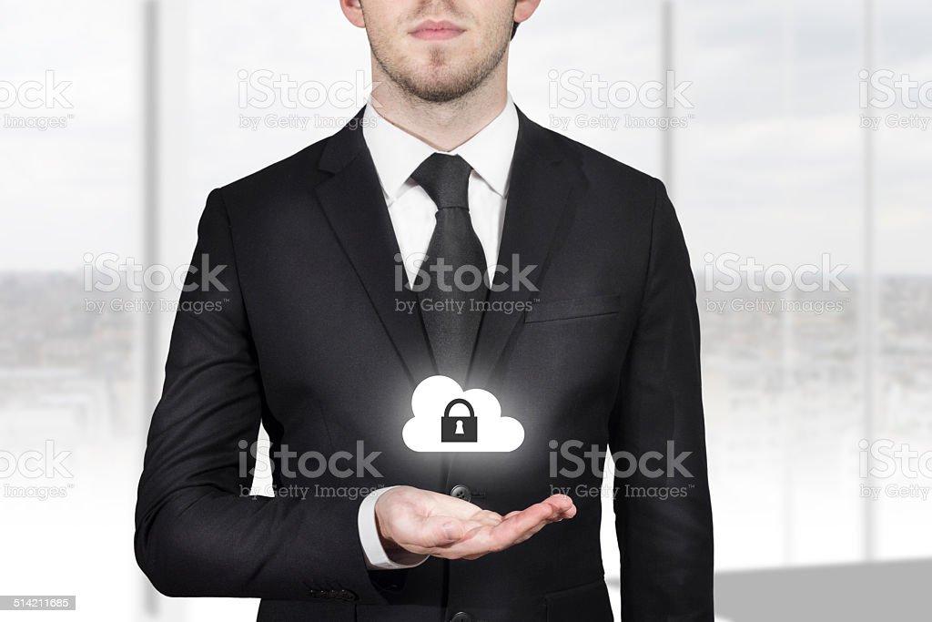 businessman holding cloud security symbol stock photo