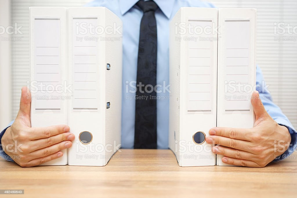 businessman holding company documentation, accounting concept stock photo