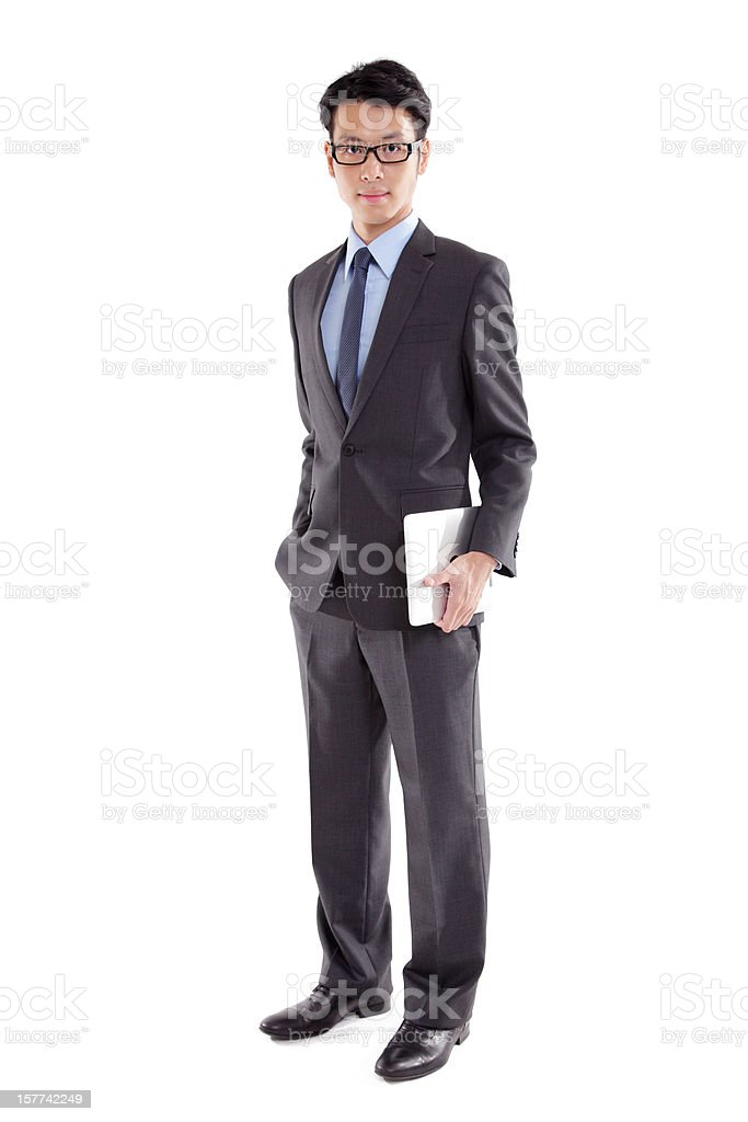 Businessman Holding Computer Tablet stock photo