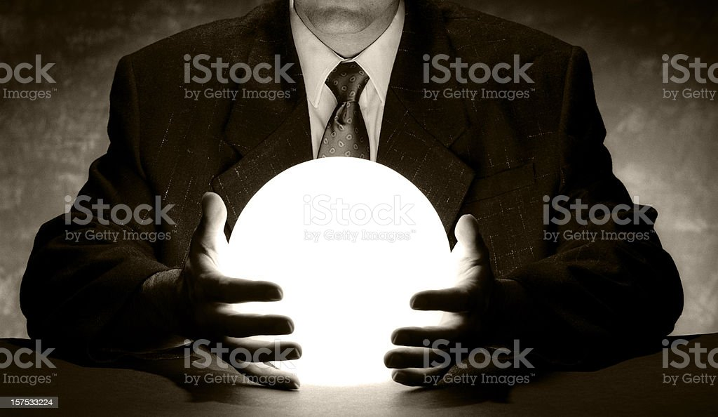 Businessman Holding Crystal Ball stock photo