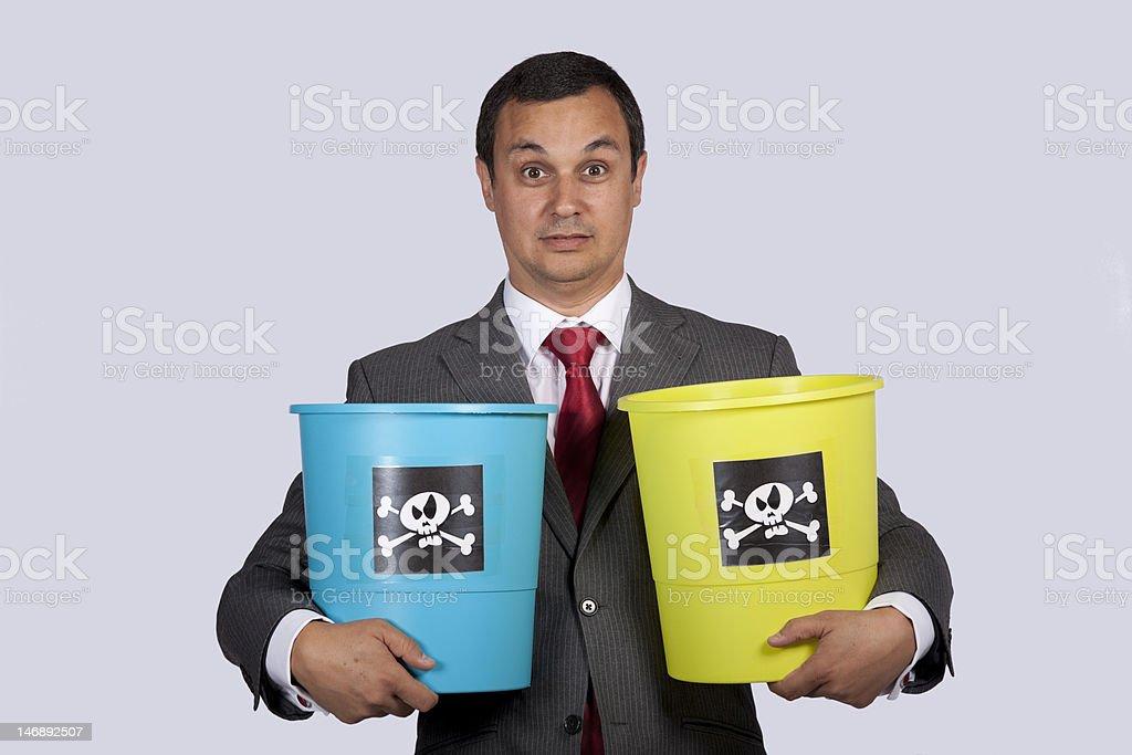 Businessman holding dangerouse buckets royalty-free stock photo