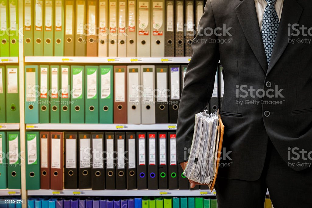 businessman holding data files stock photo