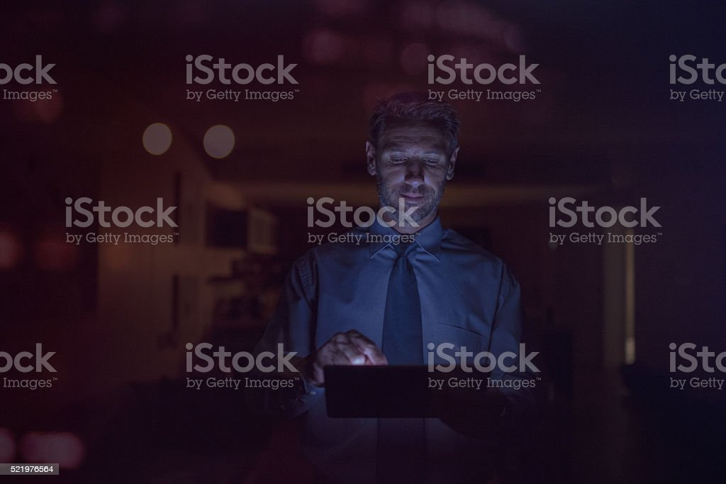 Businessman holding digital tablet and searching on internet stock photo