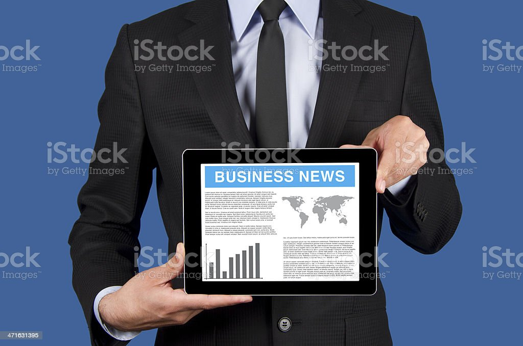 Businessman holding digital tablet pc with business news royalty-free stock photo