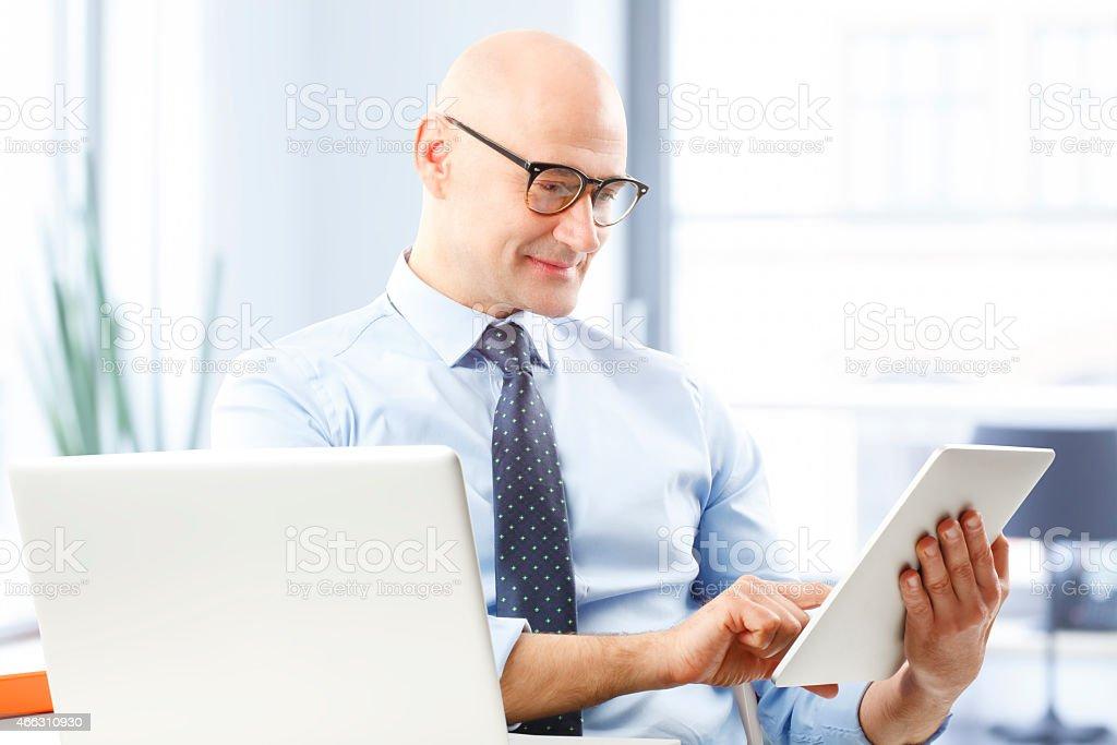 Businessman holding digital tablet stock photo