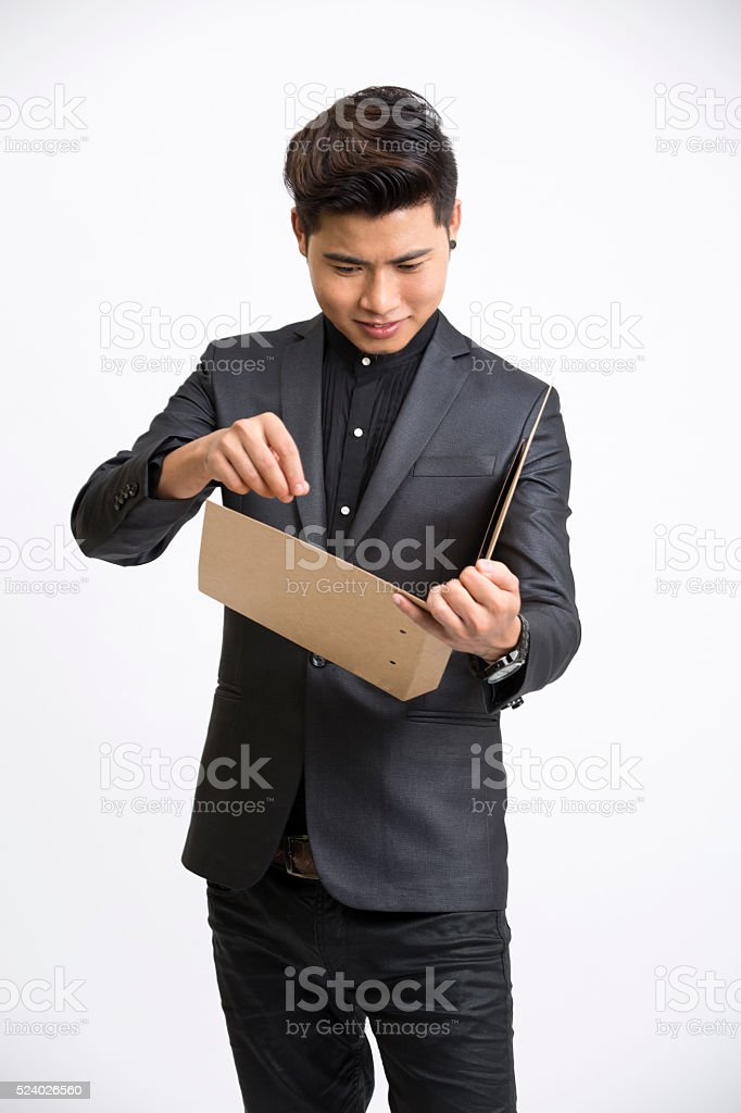 Businessman holding document in this hand . stock photo