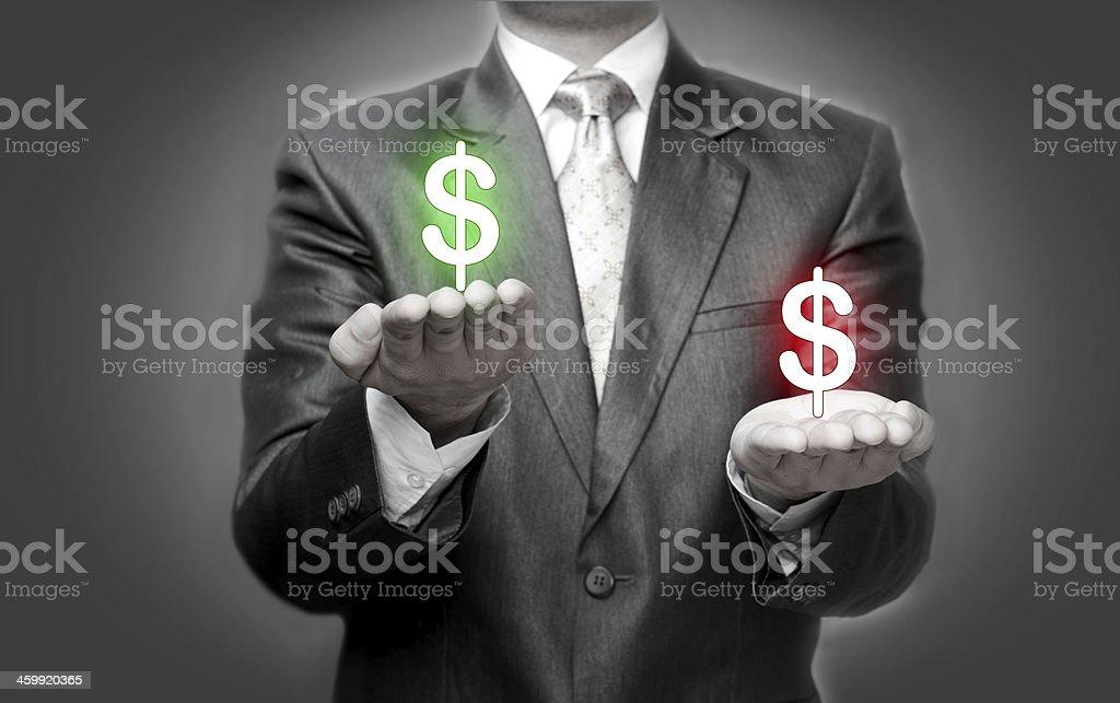 Businessman holding dollar symbols stock photo