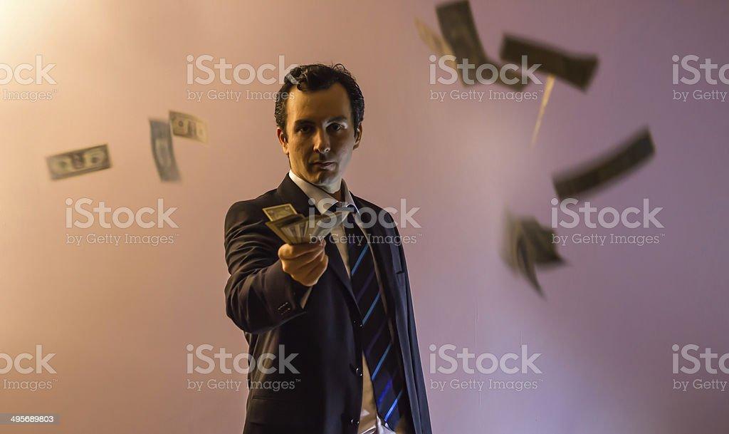 Businessman Holding Dollars Among Flying Dollars stock photo