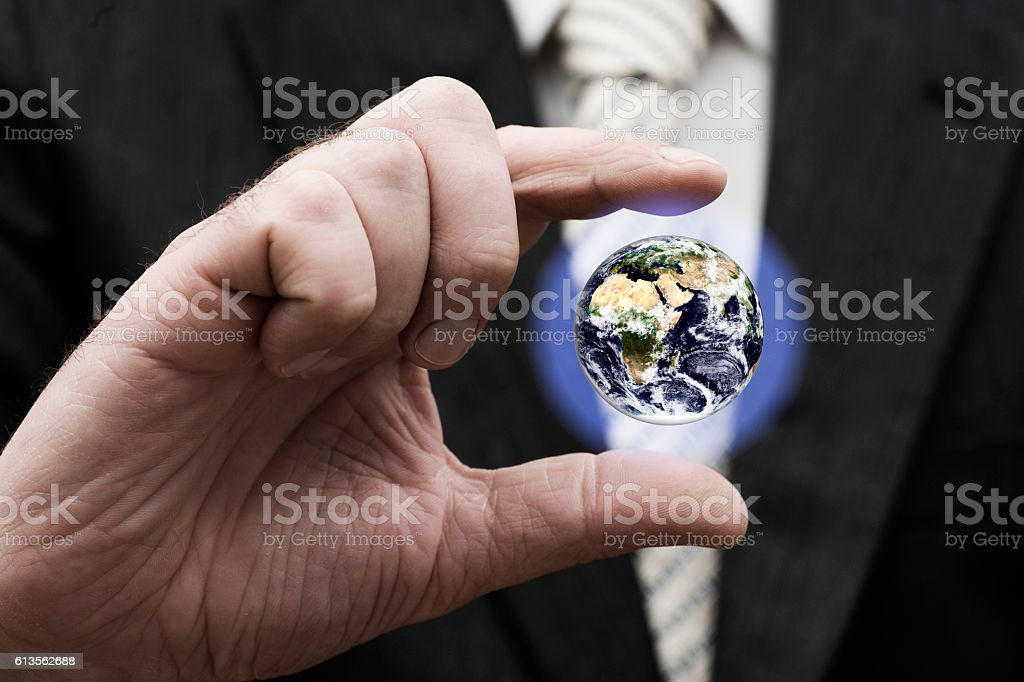 Businessman holding Earth stock photo
