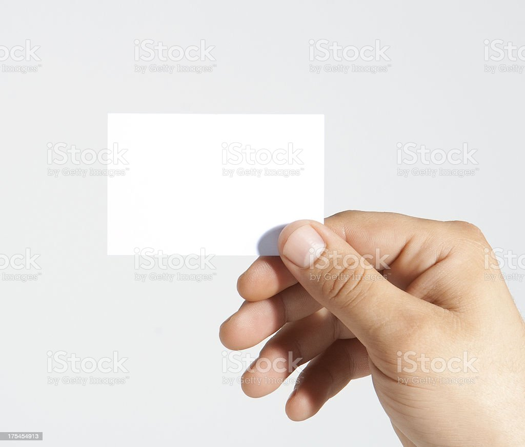Businessman holding empty card stock photo