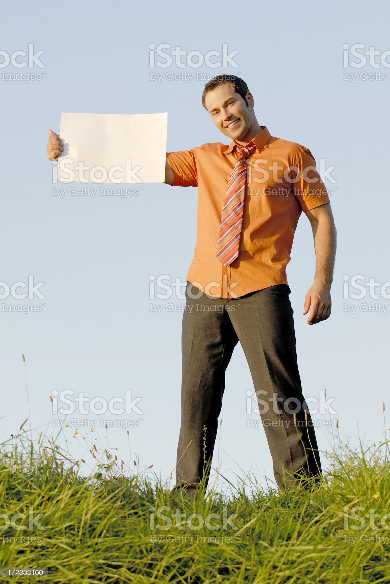 businessman holding empty sign royalty-free stock photo