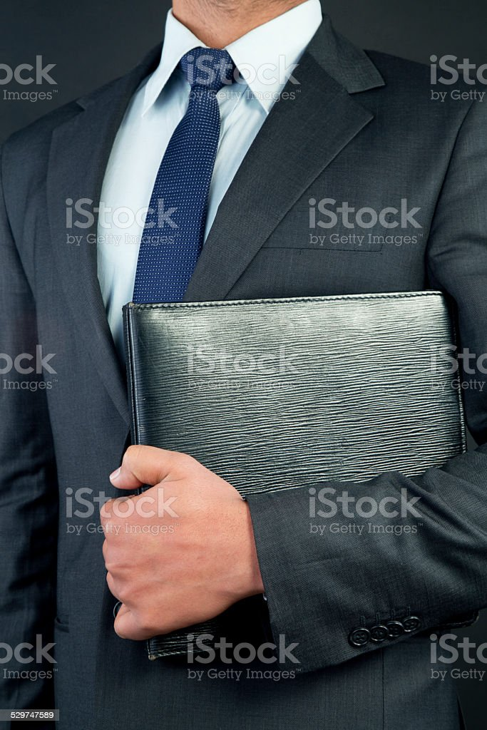 Businessman holding file stock photo