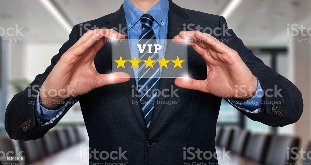 Businessman holding five star rating VIP - Office - Stock Image stock photo