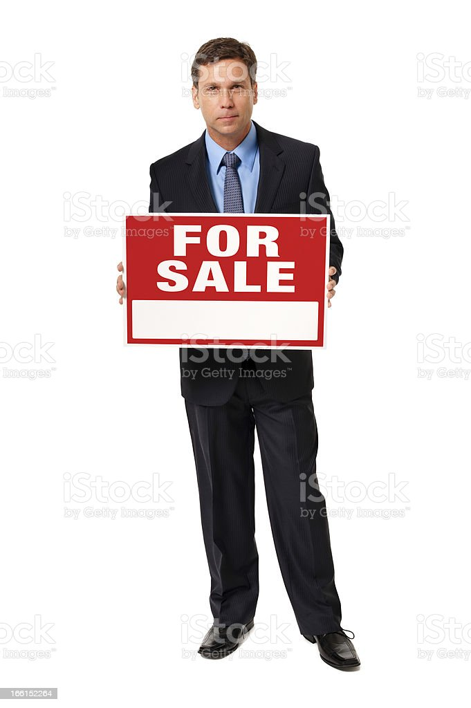 Businessman Holding For Sale Sign Isolated on White Background royalty-free stock photo