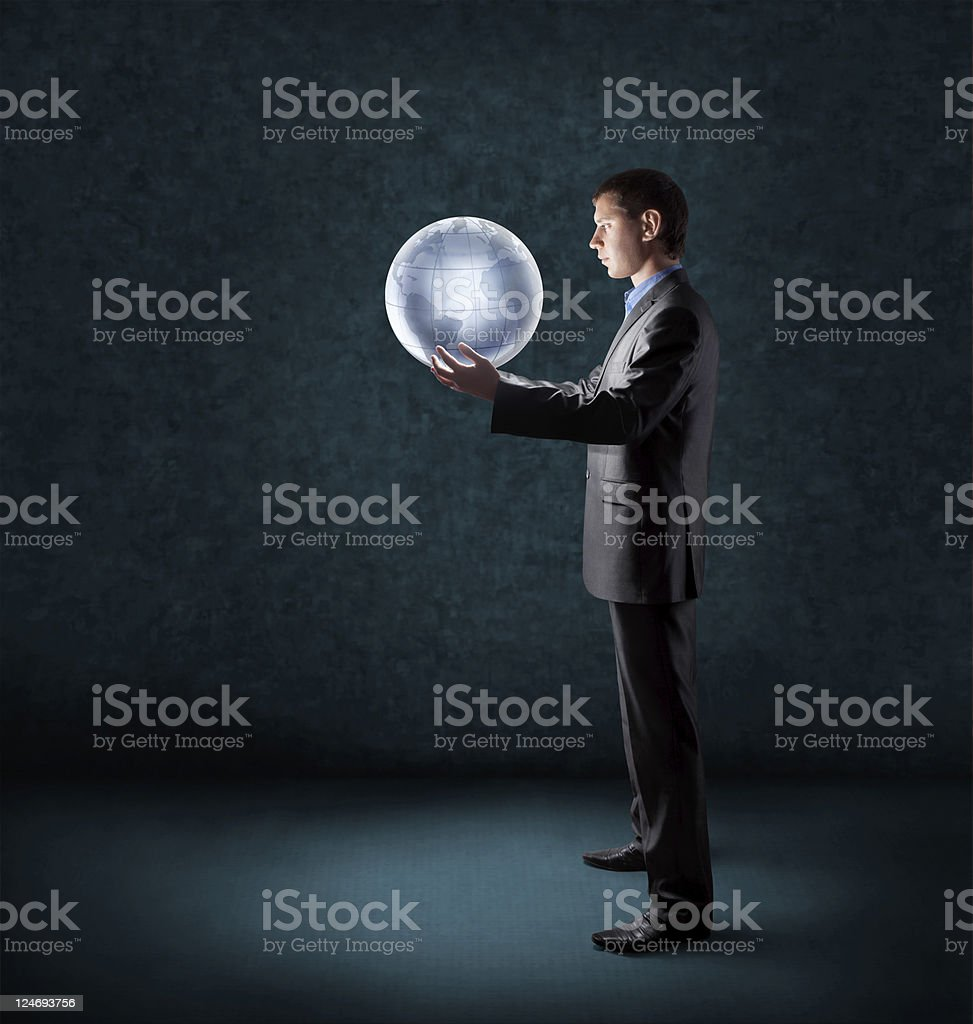 businessman holding glowing planet earth stock photo