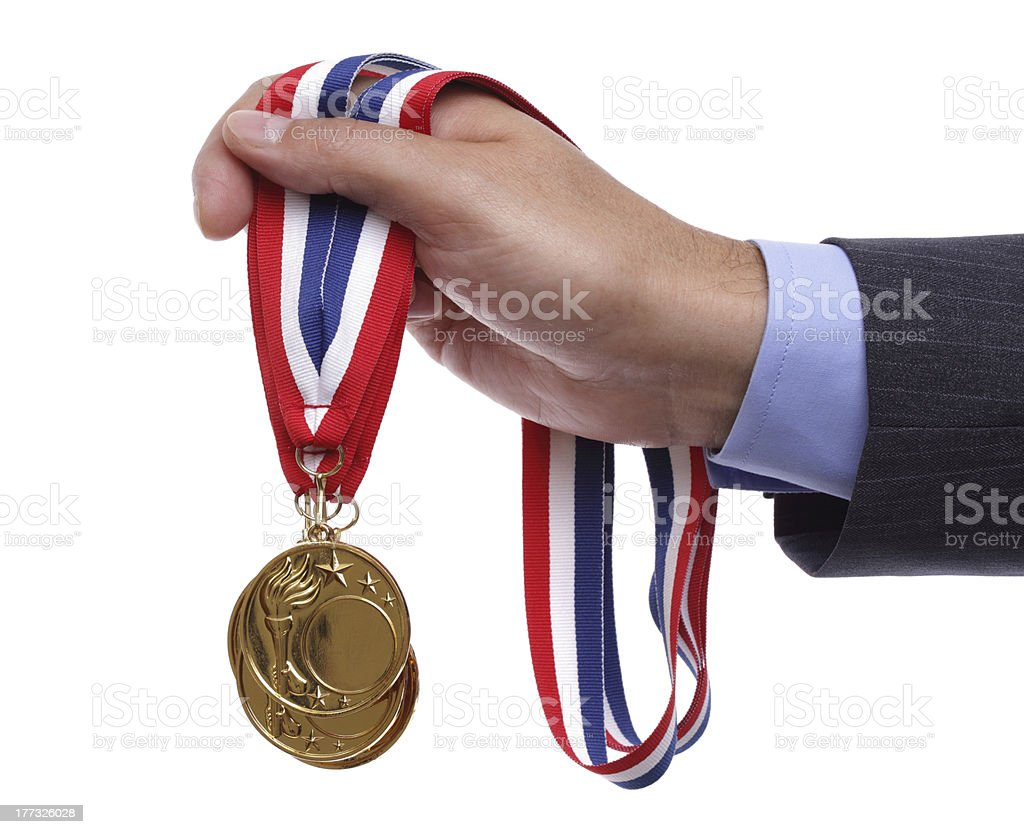Businessman holding gold medal stock photo