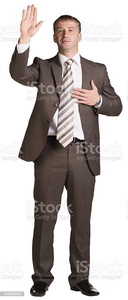 Businessman holding hand up in front of him stock photo