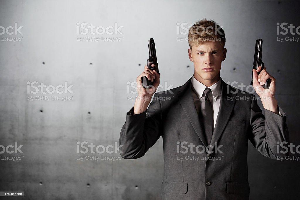 Businessman holding handguns royalty-free stock photo