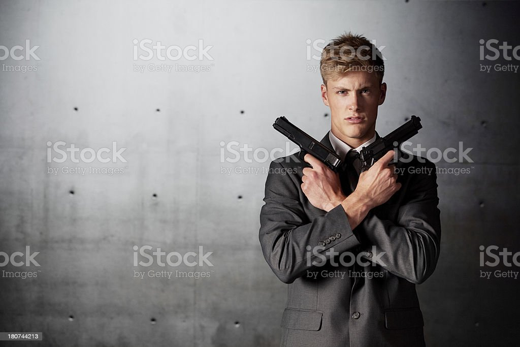 Businessman holding handguns royalty-free stock photo
