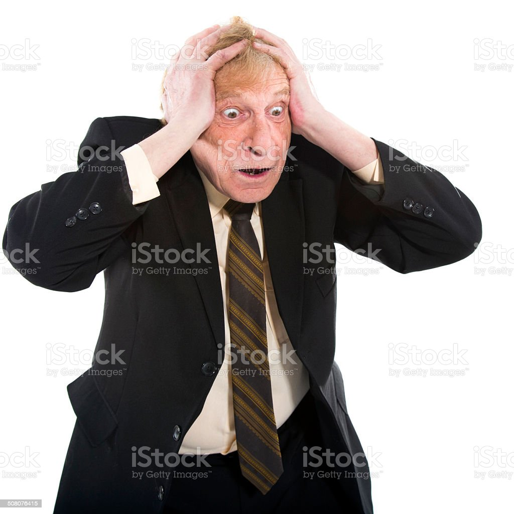 Businessman holding head in his hands stock photo