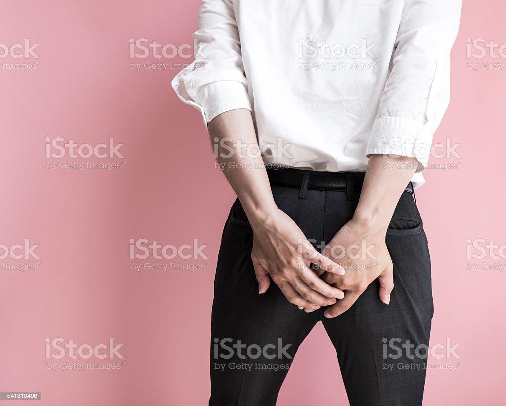 Businessman holding his bottom stock photo