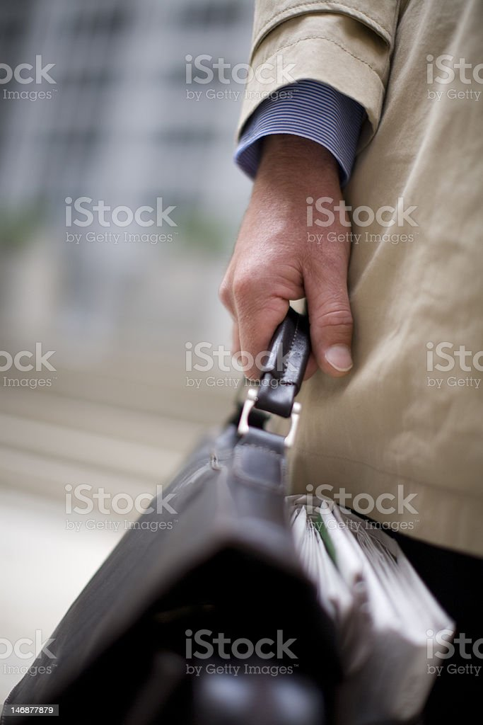 Businessman holding his briefcase royalty-free stock photo