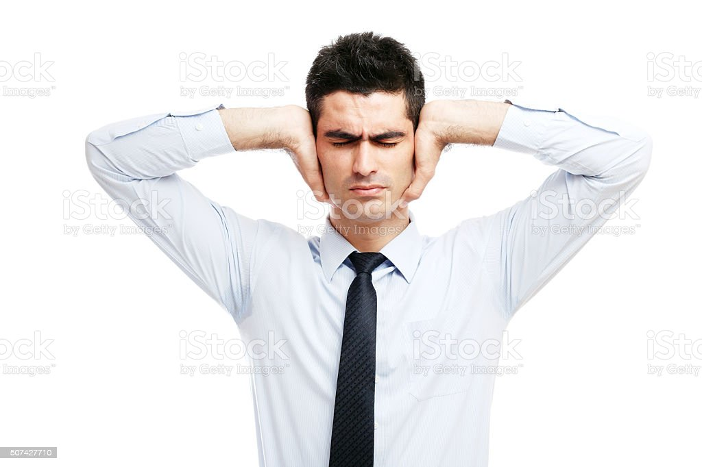 Businessman holding his hands in his ears stock photo