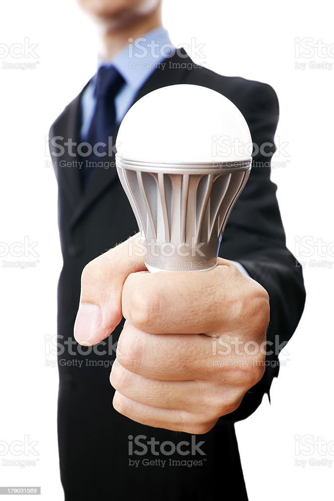 Businessman holding in his hand LED lamp royalty-free stock photo