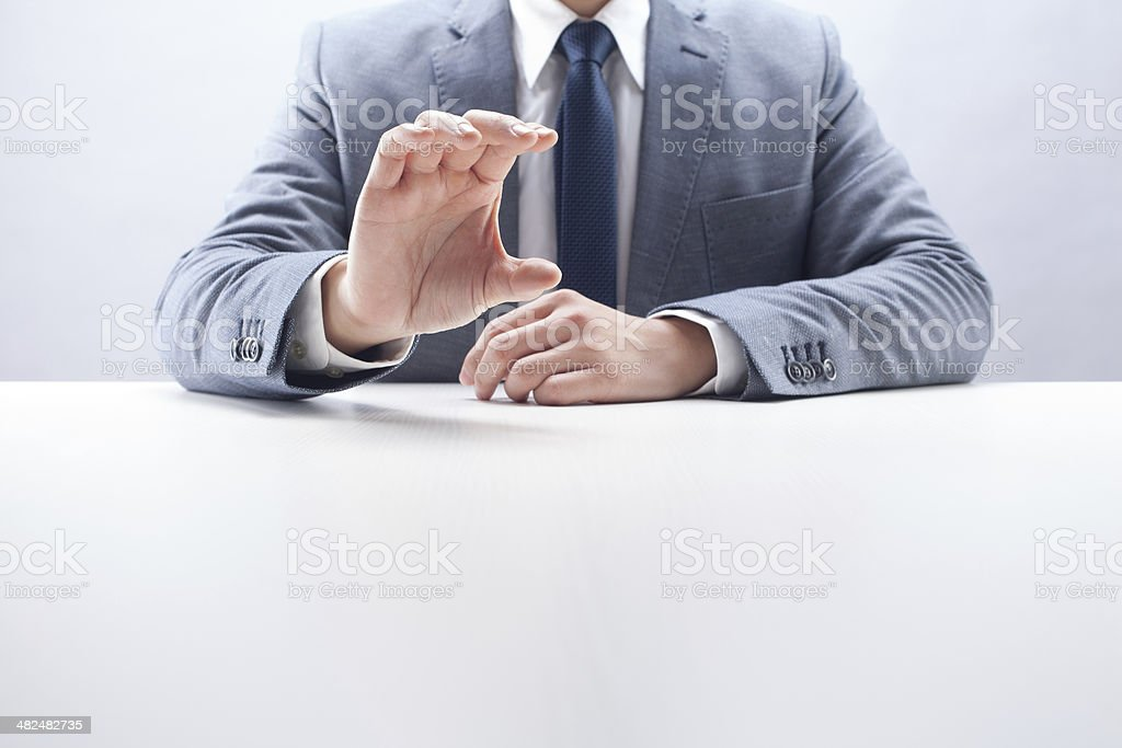 Businessman Holding Invisible Item royalty-free stock photo