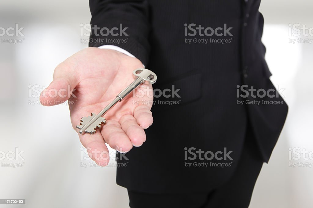 businessman holding keys royalty-free stock photo