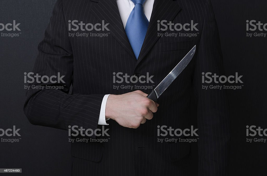 Businessman Holding Knife stock photo