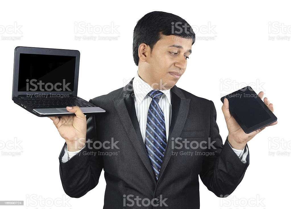 Businessman Holding Laptop and Tablet royalty-free stock photo
