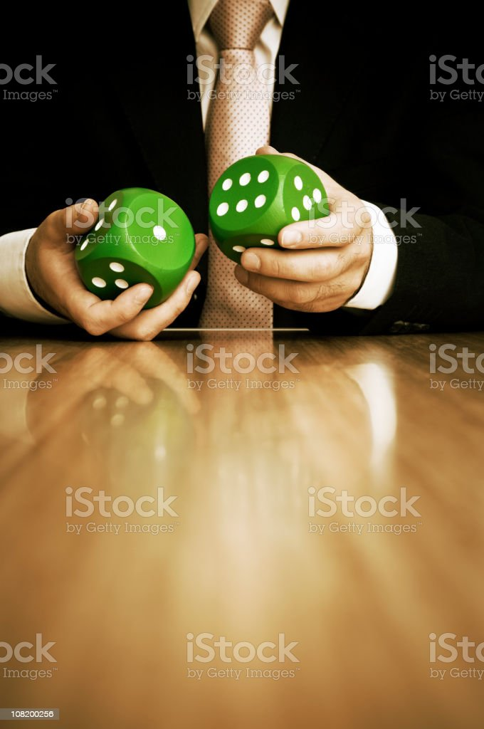 Businessman Holding Large Pair of Green Dice royalty-free stock photo