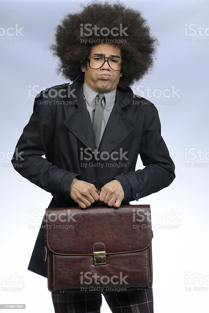 businessman holding leather briefcase blowing cheeks royalty-free stock photo