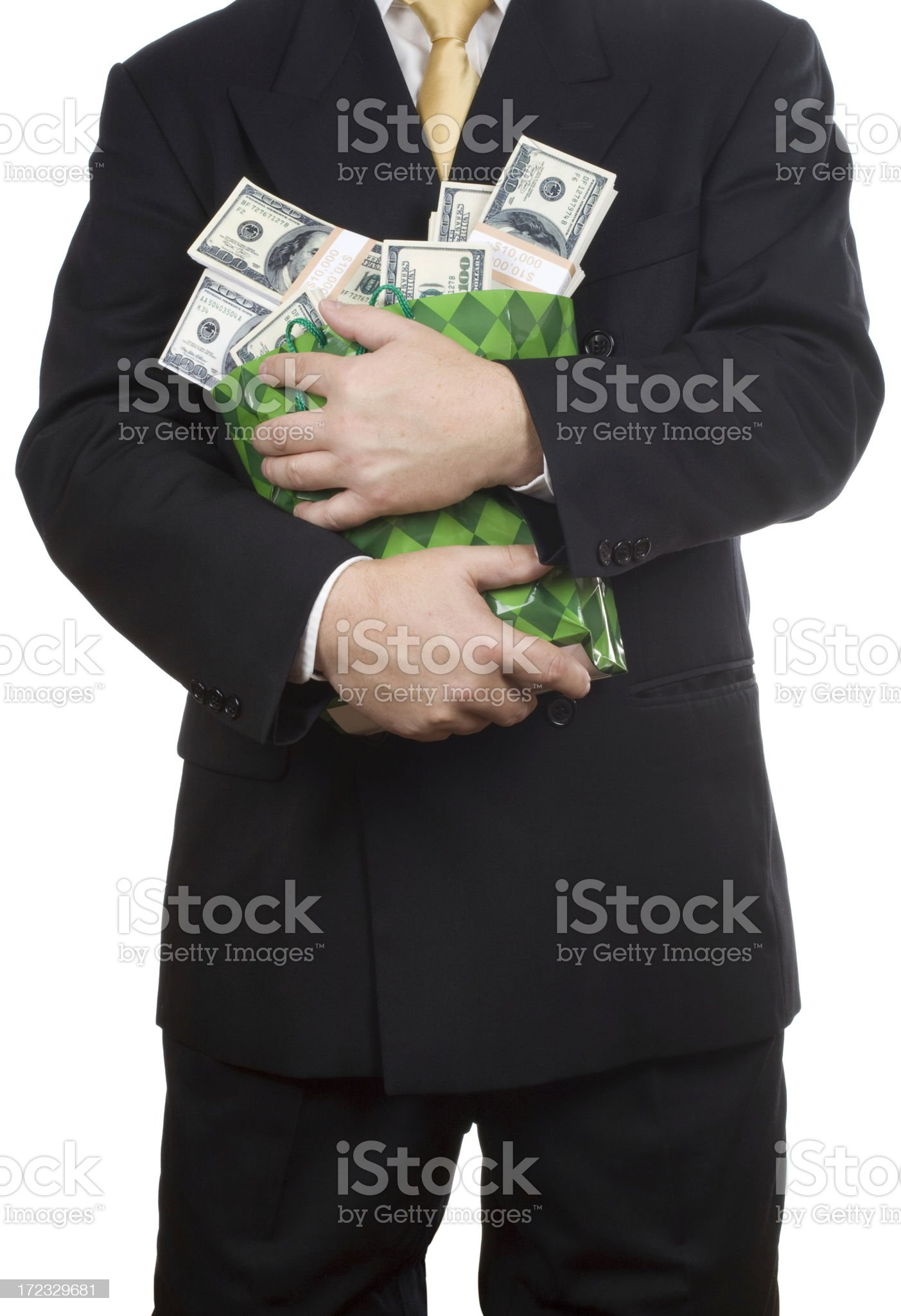 Businessman holding lots of cash royalty-free stock photo