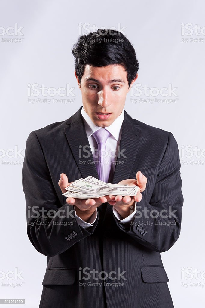Businessman holding lots of money stock photo