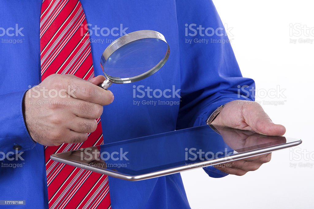 Businessman Holding Magnifying Glass and Tablet royalty-free stock photo