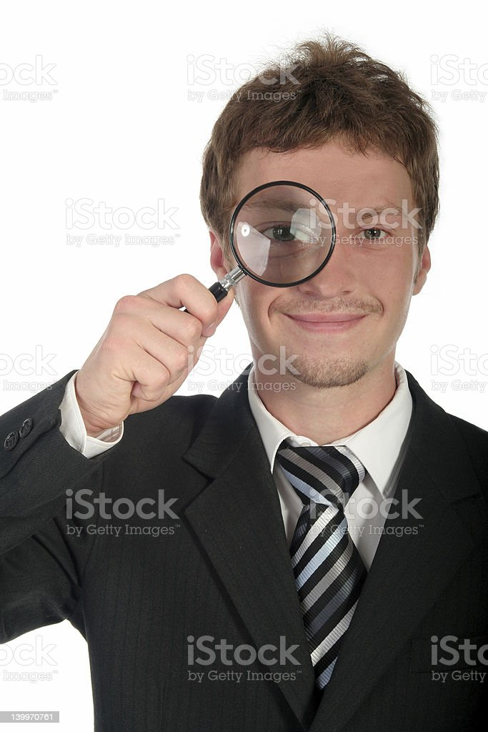 Businessman Holding Magnifying Glass royalty-free stock photo