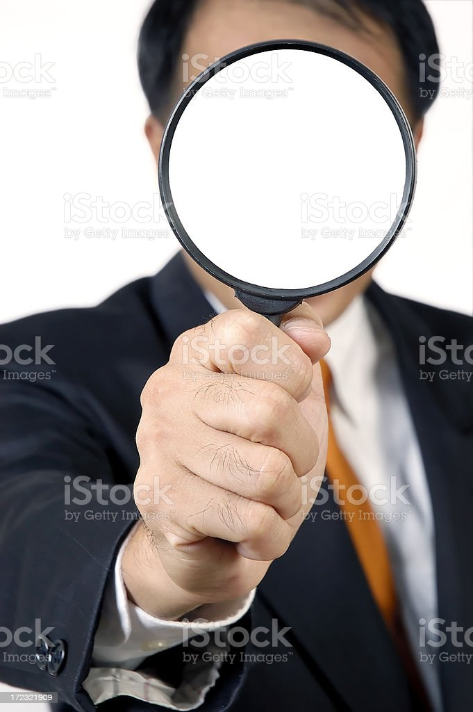 Businessman Holding Magnifying Glass stock photo