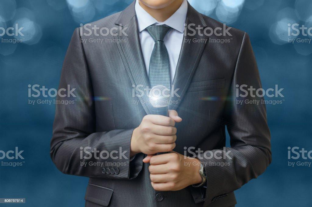 Businessman holding microphone . stock photo