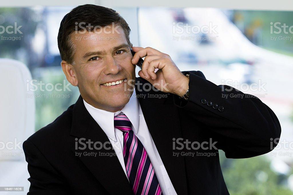 Businessman holding mobile phone stock photo