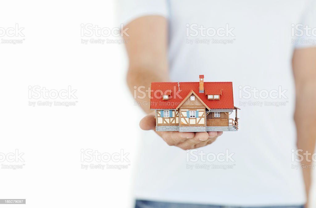 Businessman Holding Model House - Isolated royalty-free stock photo