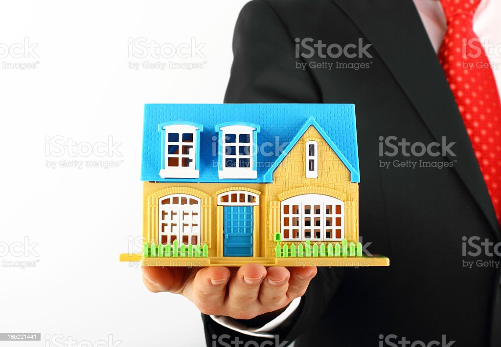 Businessman holding model house royalty-free stock photo
