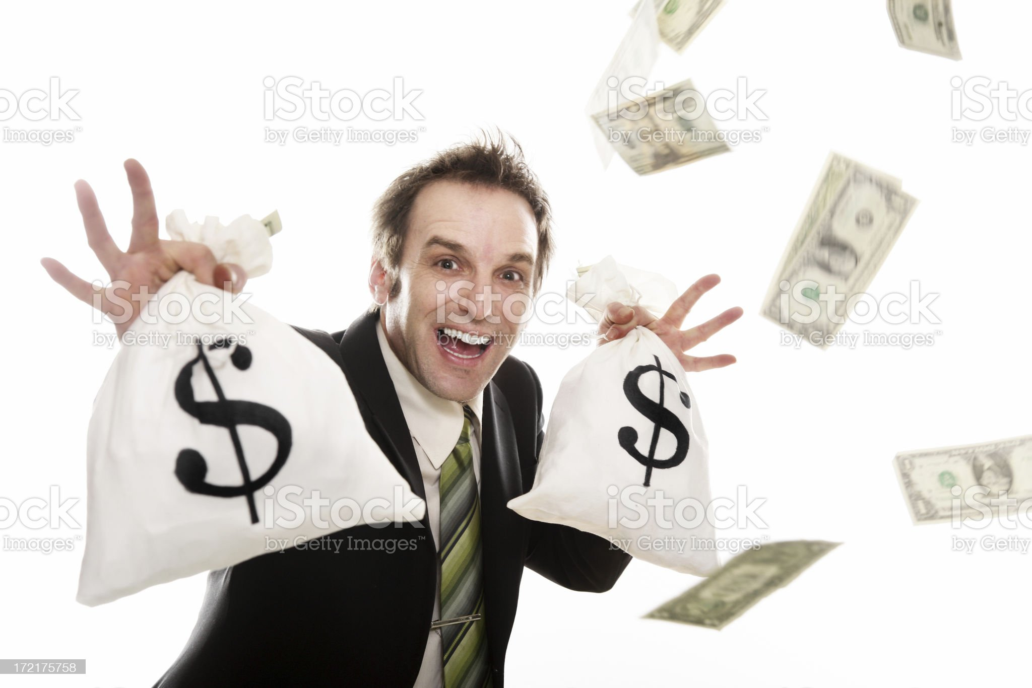 Businessman holding money bags royalty-free stock photo