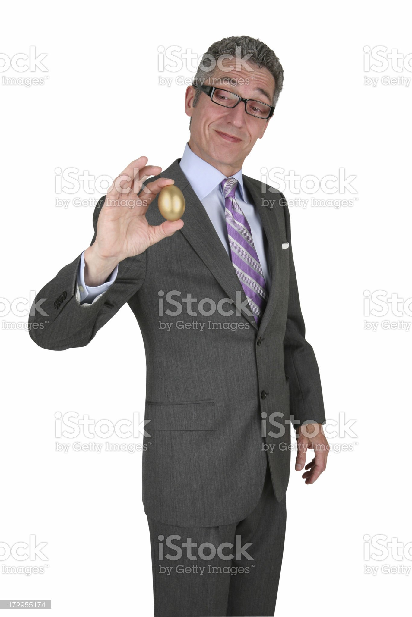 Businessman Holding Nest Egg with Clipping Path royalty-free stock photo