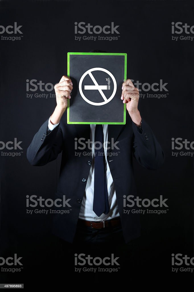 Businessman holding no smoking sign royalty-free stock photo