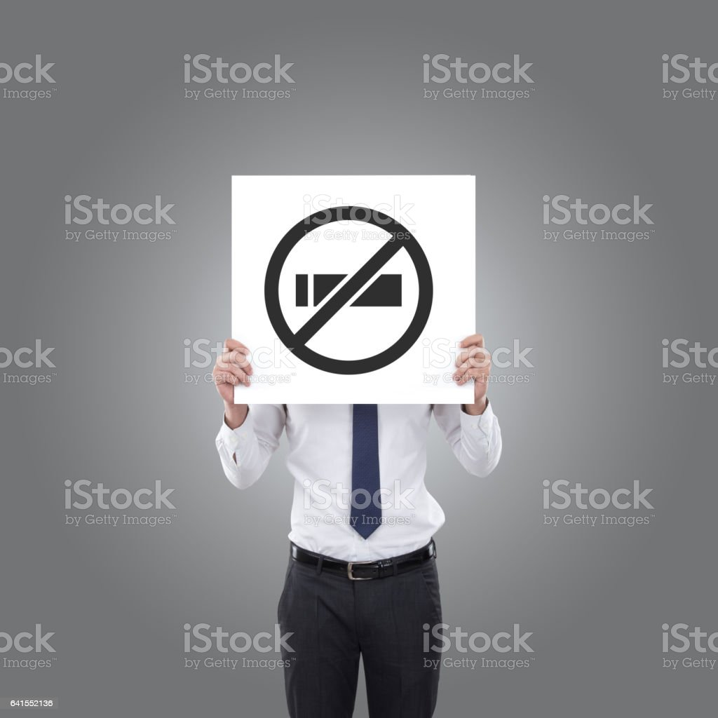 Businessman holding no smoking sign stock photo